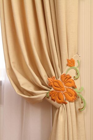 transparent dress: frament of a window curtain with the embroidered vegetative ornament Stock Photo