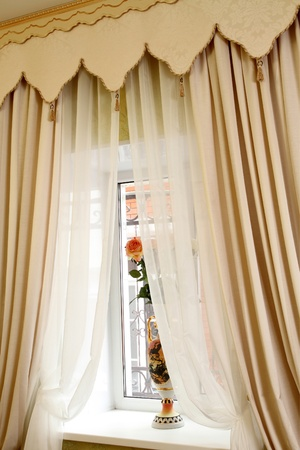 the windows decorated with curtains with a machine embroidery, double 13 Stock Photo - 13472011
