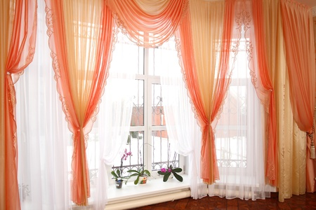 the windows decorated with curtains with a machine embroidery, double 12 Stock Photo