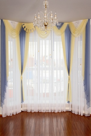 the windows decorated with curtains with a machine embroidery, double 10 Stock Photo