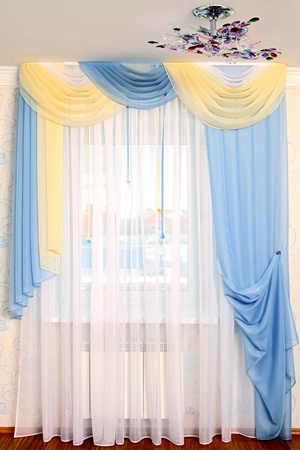 the windows decorated with curtains with a machine embroidery, double 8