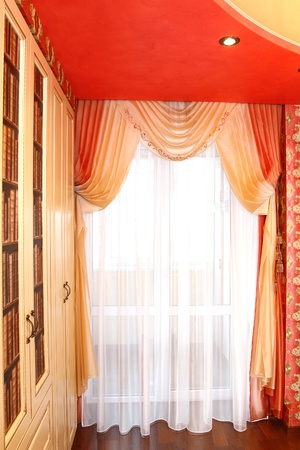 the windows decorated with curtains with a machine embroidery, double 5 Stock Photo - 13472037