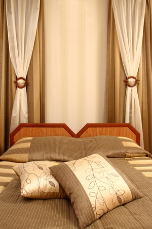 fragment of an interior of a bedroom. two beds and two pillows, vertical shot photo
