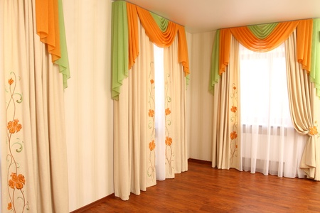 the windows decorated with curtains with a machine embroidery Stock Photo - 13472012
