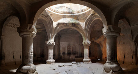 geghard: The big hall of the ancient Christian temple Geghard with a dome and columns. Editorial