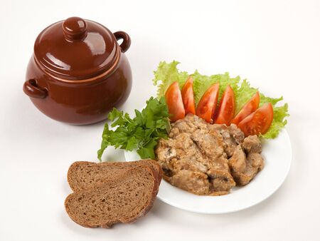 Chicken goulash with potatoes, greens vegetables and bread on a white plate photo