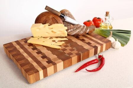 vegetable oil: bread and the cheese cut by means of a knife, vegetables and vegetable oil