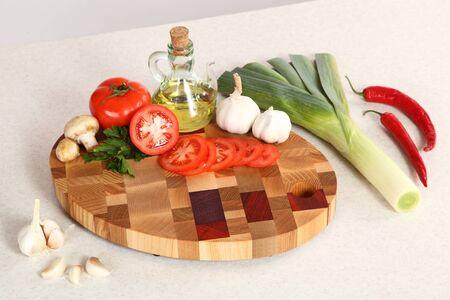 vegetable oil: Vegetable oil and vegetables on a chopping board Stock Photo