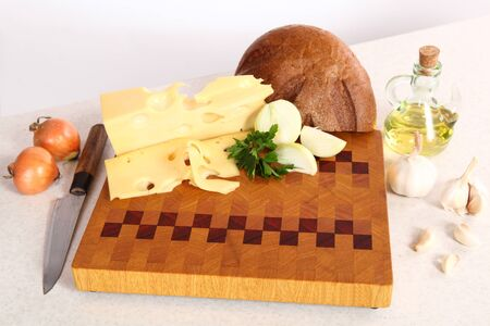 vegetable oil: Bread, cheese, vegetables on a chopping board and vegetable oil Stock Photo