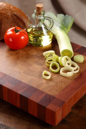 vegetable oil: vegetables, vegetable oil and bread on a chopping board Stock Photo