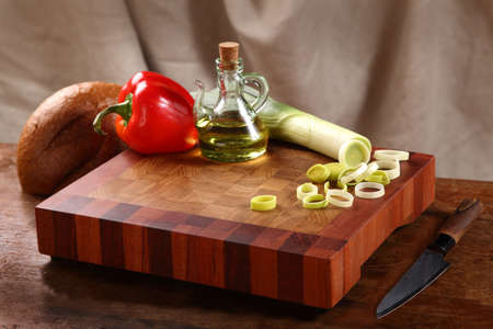 vegetable oil: vegetables, vegetable oil, knife and bread on a chopping board Stock Photo