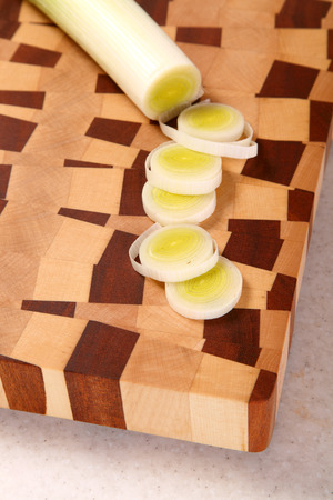 segments: the leek cut by segments on a chopping board