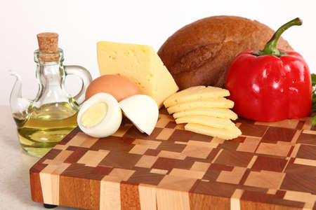 vegetable oil: cheese, pepper, egg, bread and vegetable oil on a chopping board