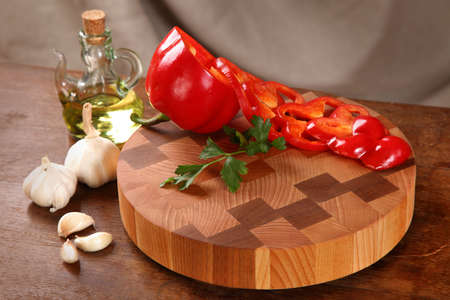 vegetable oil: the pepper cut on a chopping board, garlic and vegetable oil