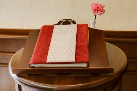 visitors: The visitors book at restaurant in classical style Stock Photo