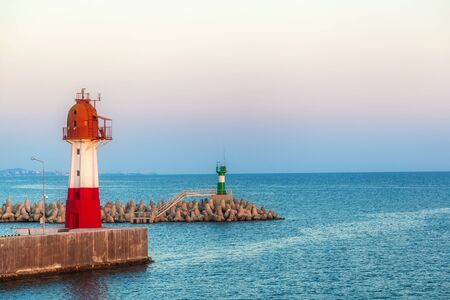 two beacons stand on pier by the sea Banco de Imagens