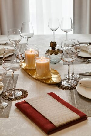 laid: the laid table with candles at restaurant in classical style