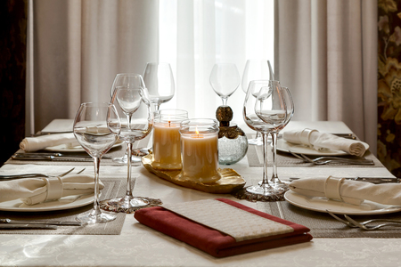 The Laid Table With Candles At Restaurant In Classical Style Stock - Restaurant table candles
