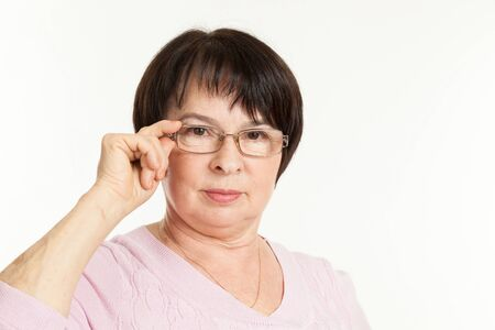 wearing spectacles: the beautiful mature woman with a severe look wearing spectacles