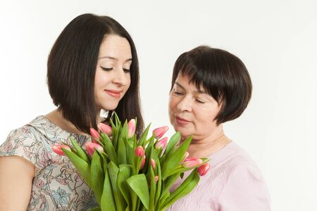 presented: the woman presented a bouquet of flowers for mother Stock Photo