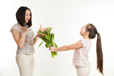 gives: the girl gives to mother a bouquet of flowers Stock Photo
