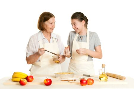grease: the grandmother and the granddaughter grease pie with a brush with egg Stock Photo