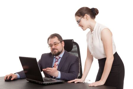 conducts: the head conducts negotiations with the secretary Stock Photo