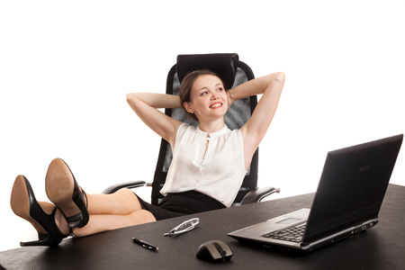 pensiveness: the business woman sits at office table with the laptop