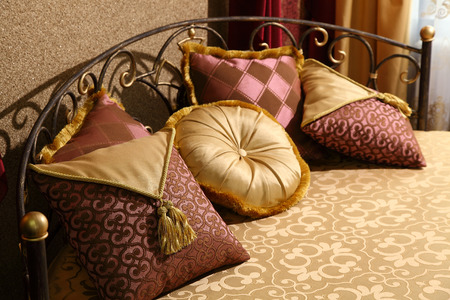 and magnificent: magnificent bed with pillows with east ornament Stock Photo