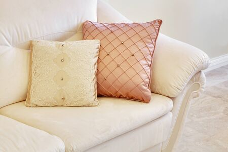 and the magnificent: magnificent light sofa with two beautiful pillows Stock Photo