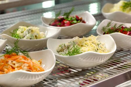 gamme de produit: the range of salads on a show-window