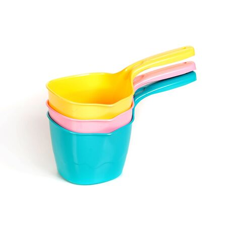 ladles: multi-colored plastic ladles on the white isolated background