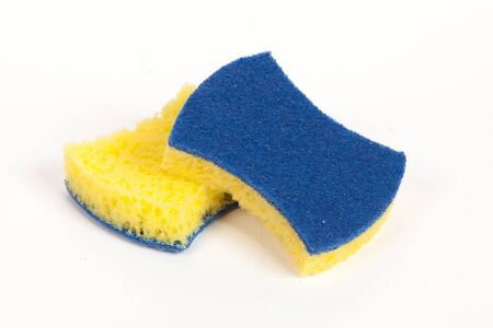 varnished: two yellow scouring sponges on the isolated white background
