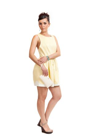 the young woman in a light dress on a white background Stock Photo