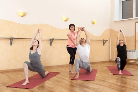 a group of people doing yoga Stock Photo