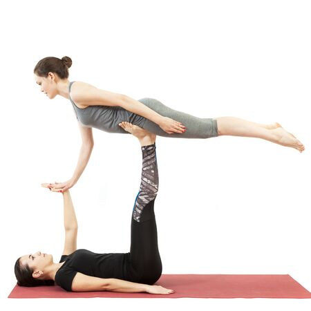 two young girls doing yoga Stock Photo