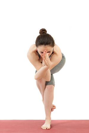 young girl doing yoga Stock Photo