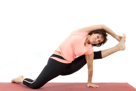 Beautiful mature woman doing yoga