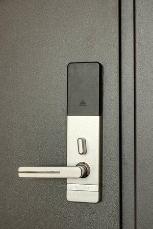 Fragment of the front door with a door handle