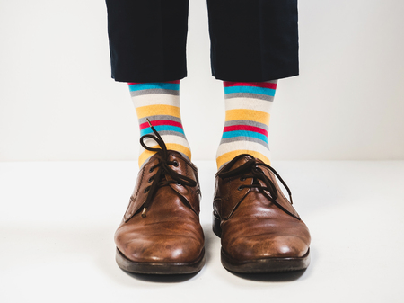 Men's feet in stylish shoes and bright socks. Men's style 写真素材