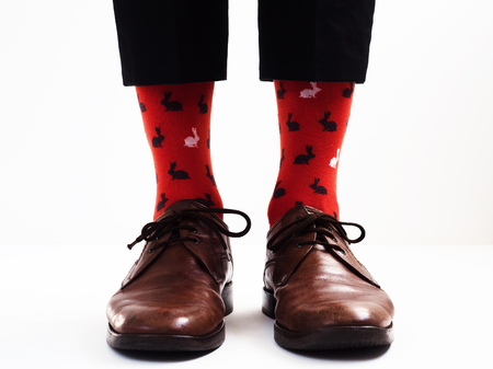 Men's legs in bright, funny socks and stylish shoes