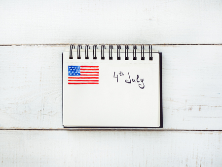 Notepad with the inscription 4th July Stock Photo