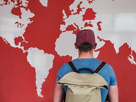 Man looking at the world map