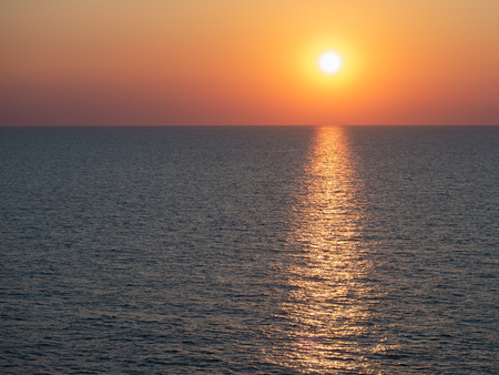 Magical sunset on the background of sea waves. View from cruise ship on the open sea