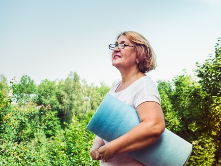 Cute, adult woman doing exercise in the park Stock Photo
