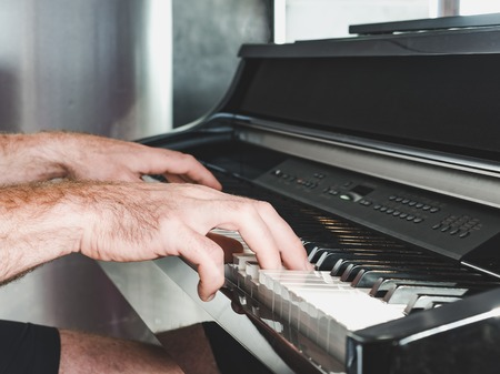Mens hands and piano. Concept of classical music