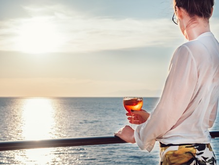 Young woman in glasses with a glass of beautiful, pink cocktail Stock Photo