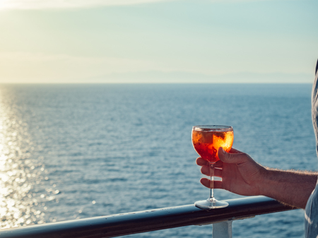 Male hand with a glass of beautiful pink cocktail Stock Photo
