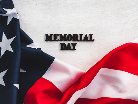 Beautiful card for the Memorial Day. Wooden letters with a congratulatory inscription on a white background. Close-up, top view. Congratulations for loved ones, relatives, friends and colleagues Stockfoto