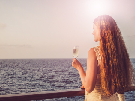 Cute woman holding a beautiful glass of champagne